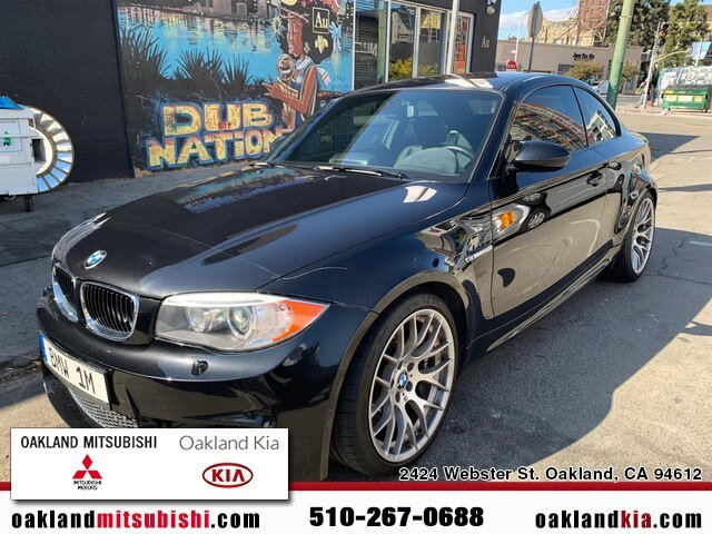 2011 BMW 1-Series M Coupe in Black Sapphire Metallic over Black Boston Leather with Orange Stitching