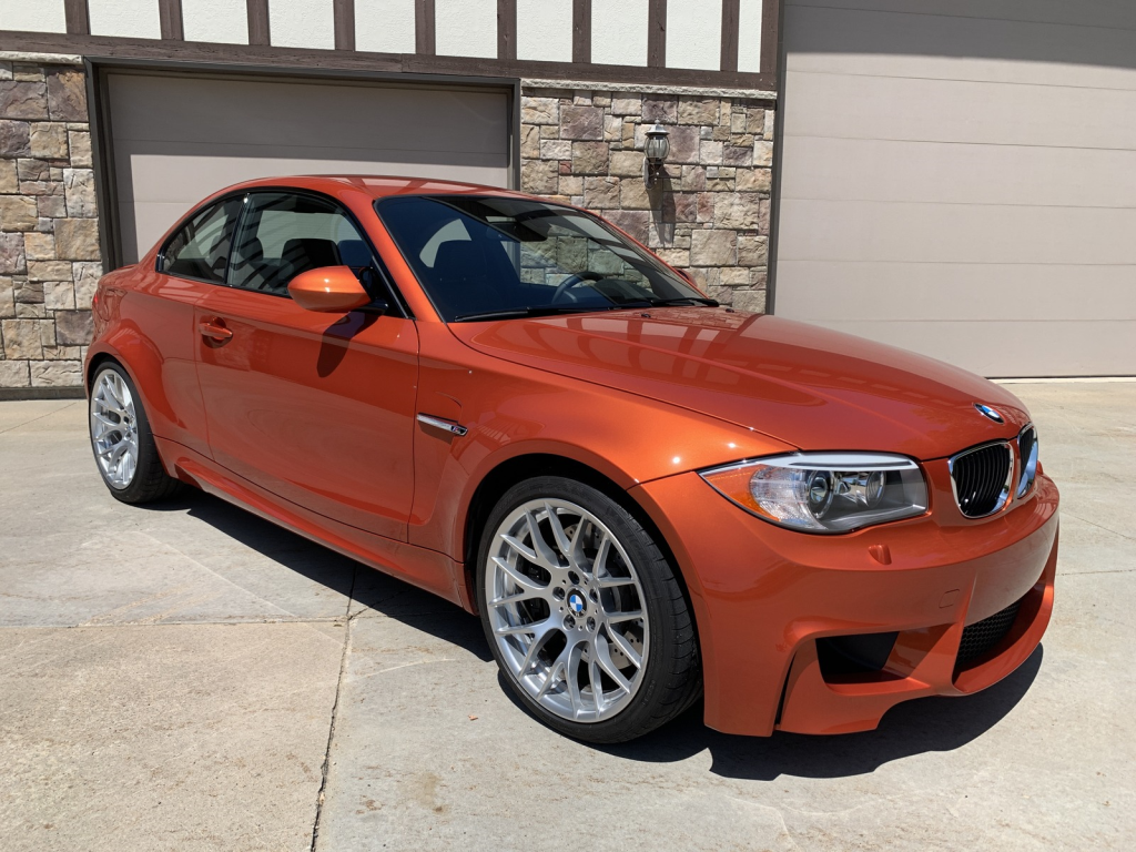 2011 BMW 1-Series M Coupe in Valencia Orange Metallic over Black Boston Leather with Orange Stitching